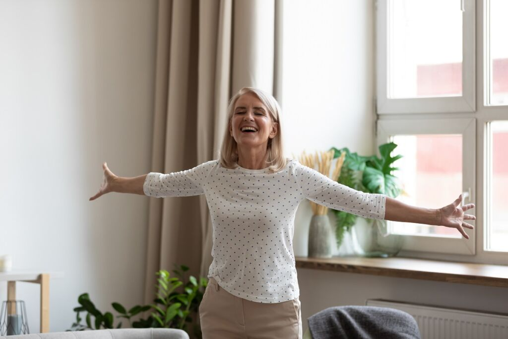 Happy,Mature,Female,Pensioner,Stand,With,Arms,Open,Feel,Positive